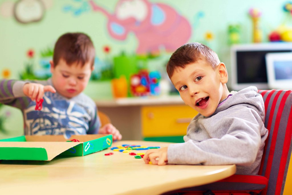 Two boys with disability at kindergarten