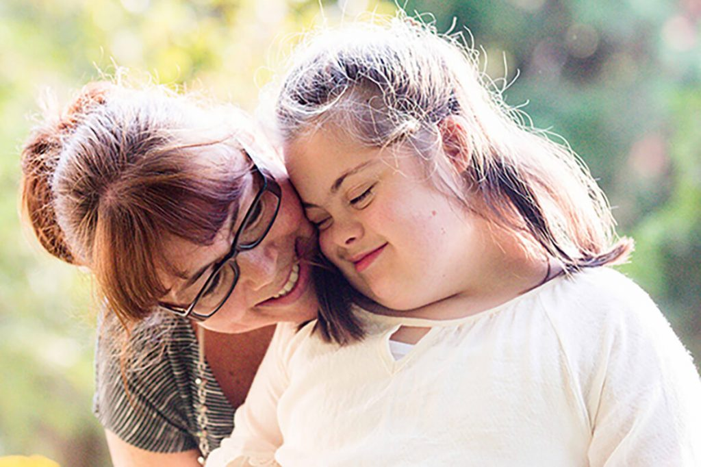 Mother with her daughter who has autism and down syndrome.