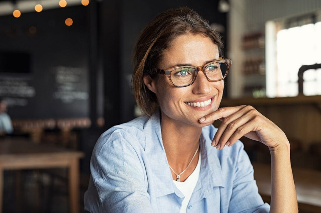 Smiling woman wearing glasses.